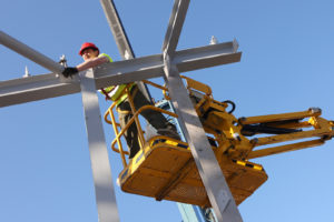 bigstock-Steel-worker-on-cherry-picker-12008195