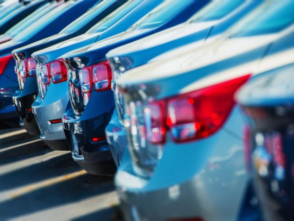 Parked Cars on a Lot. Row of New Cars on the Car Dealer Parking Lot. Cars Market Theme. ** Note: Shallow depth of field