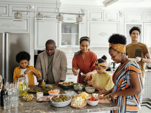 extended family making dinner together