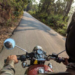 man riding motorcycle around curve